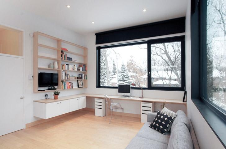 La nouvelle pièce intègre chambre, rangement, bureau et petit salon à l'intérieur d'un même espace.