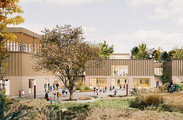 Une grande promenade végétalisée ceinturant le bâtiment offre accès à chacune des courettes dédiées aux différents cycles d'apprentissage.