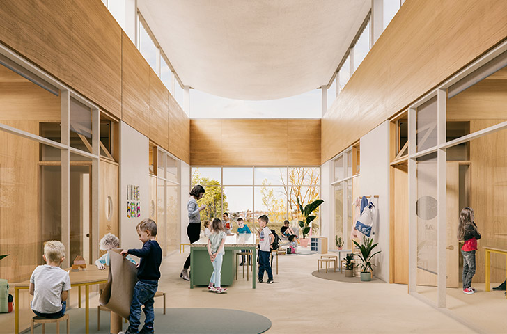 Lieu de transition entre l'école et les classes, cet espace est polyvalent et suggère une subdivision entre 3 grandes zones : travaux de groupe, cuisine centrale et petit salon de lecture individuel.