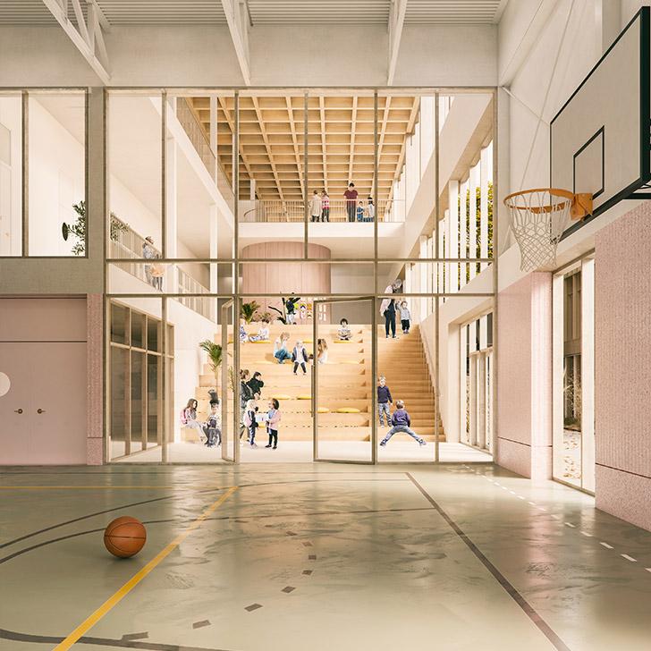 Depuis l'entrée, on peut ainsi entendre les enfants jouer en contrebas près des gradins, les voir à l'action dans le gymnase ou en train d'étudier dans le préau situé sous son toit.